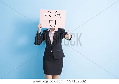 business woman take smile billboard and thumb up isolated blue background