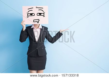 business woman take tired billboard and show something isolated blue background