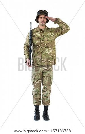 Portrait of soldier holding a rifle and saluting against white background