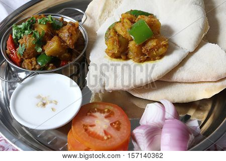 Nepali cuisine potato curry aloo served with roti