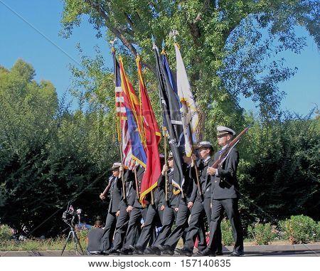 PHOENIX, AZ- NOV. 11: Military color guard marching at the Veteran's Day Parade in Phoenix, Arizona on November 11, 2013.
