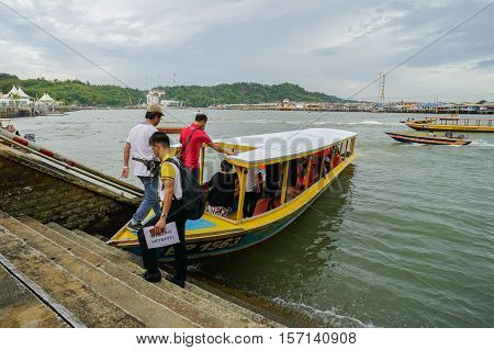 Bandar Seri Begawan,Brunei-Nov 10,2016:Tourists on board of Brunei's water taxi at behind the Yayasan Sultan Haji Hassanal Bolkiah mall.Water taxi is one of attraction tourists in Brunei Darussallam.