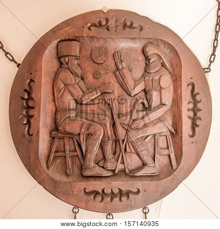 Traditional Russian styled picture carved on wood with wisemen