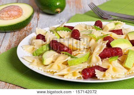 Farfalle Pasta Warm Salad With Avocado Slices And Smoked Sausages