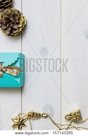 Christmas gift blue on a white wooden background. New Year present.