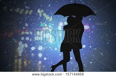 Silhouette of loving couple standing under an umbrella during a rain on the background of the city at night