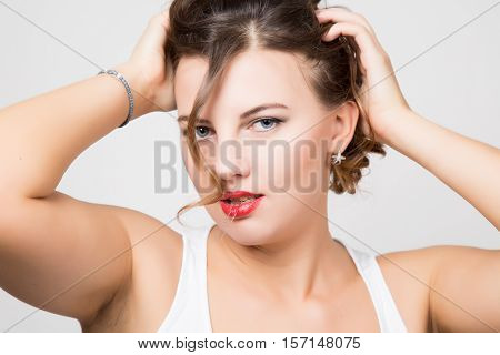beautiful woman face portrait with red lips, unruly curl.