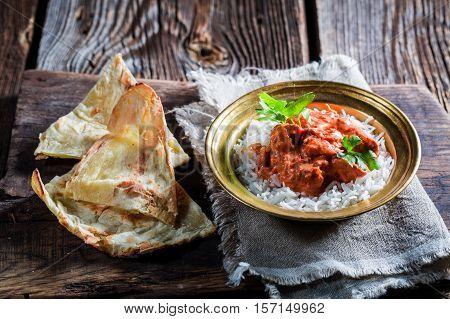 Indian Tikka Masala With Rice And Sauce