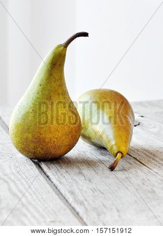 Pear on a wooden table. Fresh food.