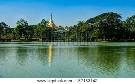 View to Shwedagon pagoda from Kandawgyi Lake Yangon Myanmar