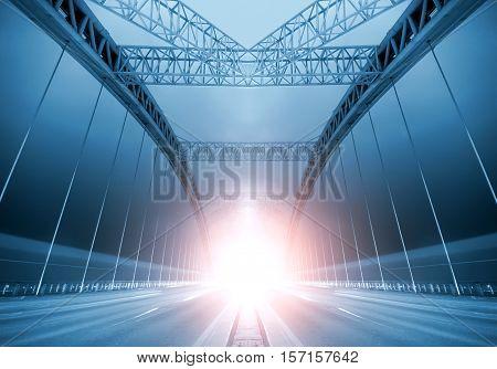 Modern bridges light up brightly at night.