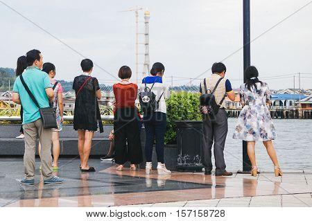 Bandar Seri Begawan,Brunei-Nov 10,2016:Tourists enjoying view of stilt houses of water village at Brunei Darussalam.Bruneians still prefer the lifestyle of the water village to residency on dry land