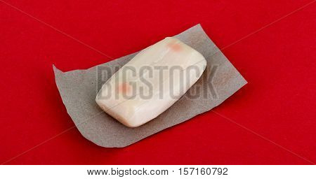 picture of a unused soap with cocoa aroma on red bakground