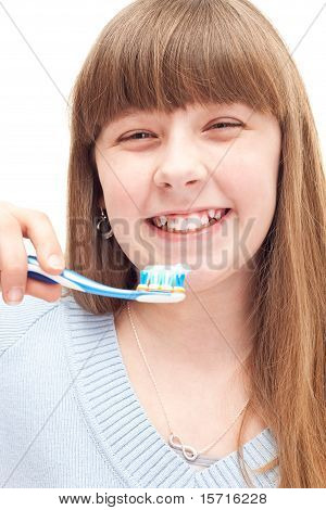 little girl brushing teeth with manual toothbrush isolated on white poster