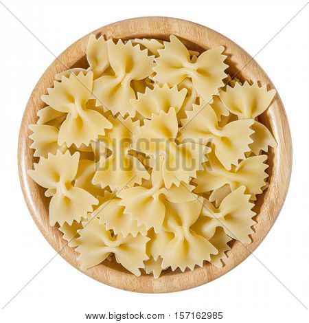 Dry bow tie pasta in wooden bowl isolated on white background with clipping path