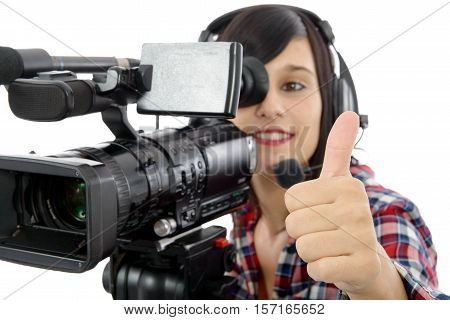 pretty young brunette girl with a professional camcorder isolated on white background