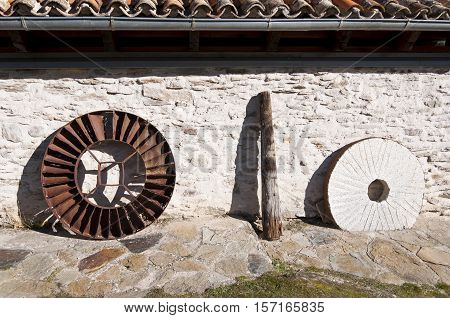 Waterwheel wooden axle and millstone of an old restored water mill. Picture taken in La Hiruela Madrid Spain