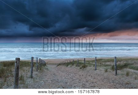 path to north sea beach at storm North Holland Netherlands