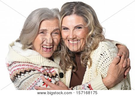 Portrait of senior woman with daugther hug isolated on white background