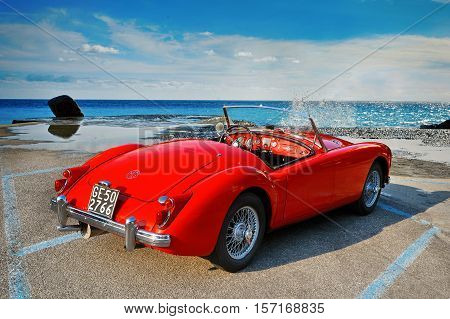 Camogli, Italy - July 21, 2015: MGA 1500 Roadster, 1960 iconic British open-top classic 2-door roadster in vintage style on seascape.