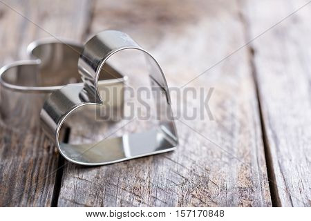 Heart shaped cookie cutter on wooden table, Valentines day baking concept