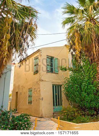 The old house in poor residential neighborhood of Heraklion Crete Greece.