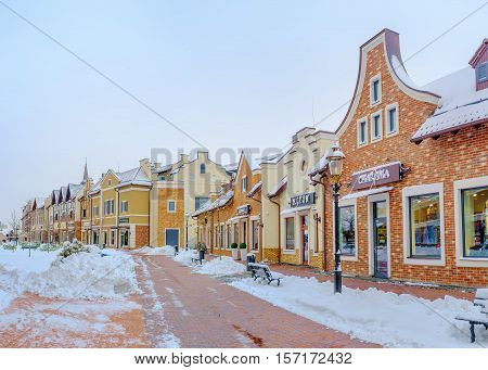 KIEV UKRAINE - NOVEMBER 11 2016: The scenic Dutch houses occupied with boutiques and cafes and surrounded by snowy streets on November 11 in Kiev.