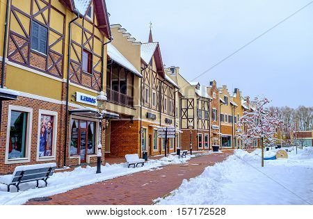 KIEV UKRAINE - NOVEMBER 11 2016: The Dutch style outlet city covered with snow and looks attractive for visitors on November 11 in Kiev.