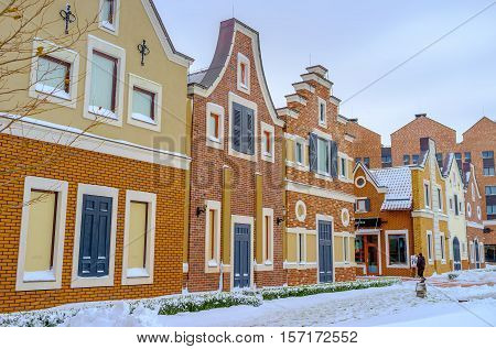 KIEV UKRAINE - NOVEMBER 11 2016: The atmosphere of old Holland in Dutch style shopping neighborhood consisting of brick gambrel-roofed houses with wooden shutters and doors on November 11 in Kiev.