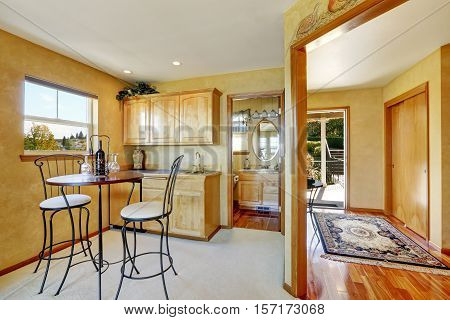 Entryway Of Duplex House. View Of Dining Area With Cabinets