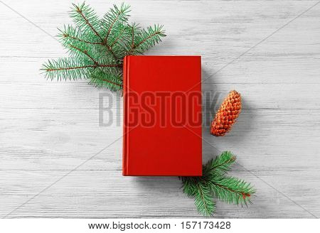 Xmas composition with book and fir tree branch