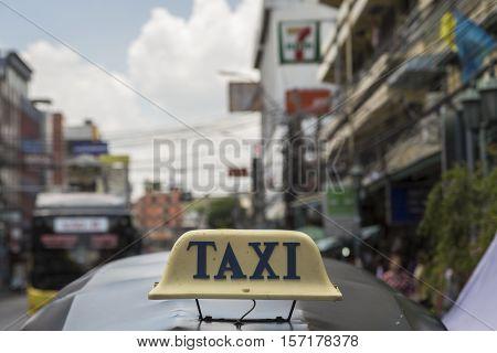 BANGKOK THAILAND - JUL 24 : taxi cab sign on top tuktuk car near Khaosan road on july 24 2016 thailand. tuktuk is popular taxi service for tourists