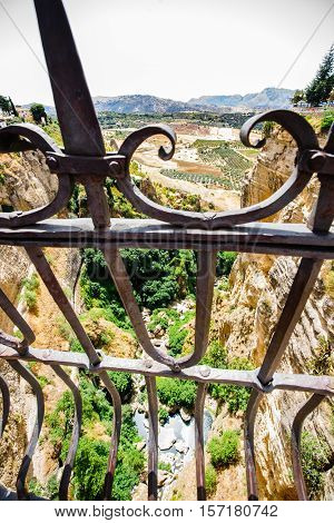 The Puente Nuevo is the newest and largest of three bridges that span the 120-metre (390 ft)-deep chasm that carries the Guadalevín River and divides the city of Ronda in southern Spain.