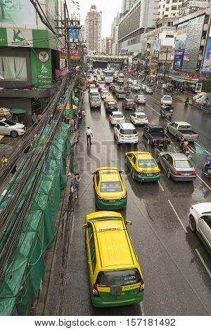 BANGKOK THAILAND - OCT 2 : taxi service in traffic on Petchaburi Road in rainning day in Pratunam area on october 2 2016 thailand.