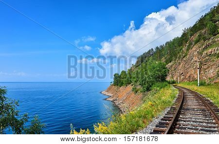 Plot Circum-Baikal railway near steep bank of Lake Baikal. Irkutsk region. Siberia. Russia