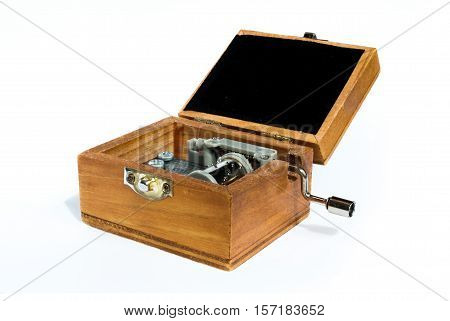 Opened Wooden music box on white background