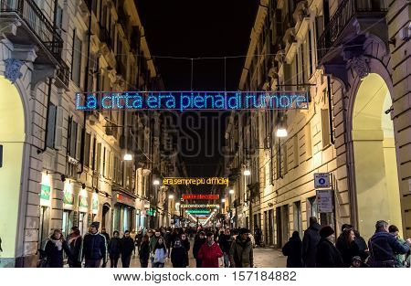 Turin, Italy - December 31, 2015 : Christmas lights and tourists on new year's eve in Via Garibaldi in Turin Italy. The city used to be a major European political centre being Italy's first capital city in 1861.
