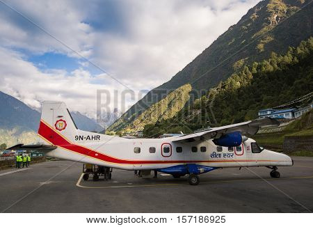 LUKLA NEPAL - OCTOBER 21 2016: Airplane on Tenzing-Hillary Airport in Lukla Himalayas Nepal.
