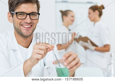 Young Scientist Conducting An Experiment