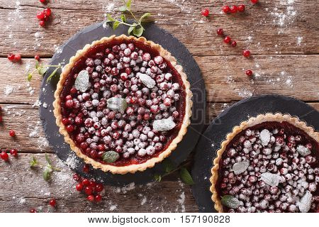 Cranberry Tart With Jam, Powdered Sugar And Mint Close-up. Horizontal Top View