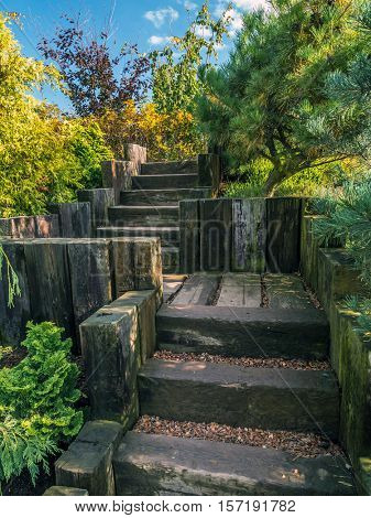 Old wooden stairs in beautiful garden