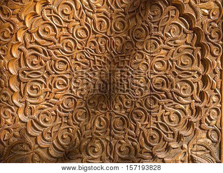 Woodcarving of the entrance door to the Palace of the Counts of Cervellon arabic pattern