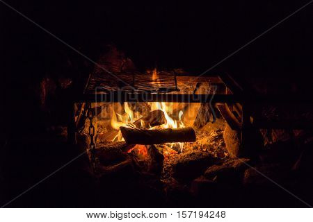 Camping outdoors lighting a cosy campfire for warmth