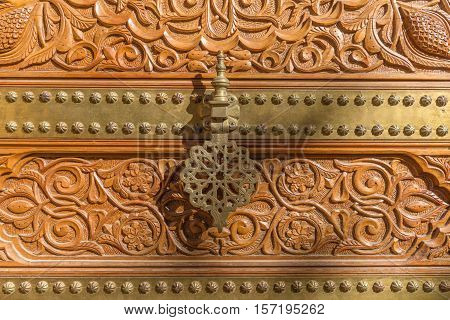 Bronze door caller of the entrance to the Palace of the Counts of Cervellon arabic pattern Anna Valencia Spain