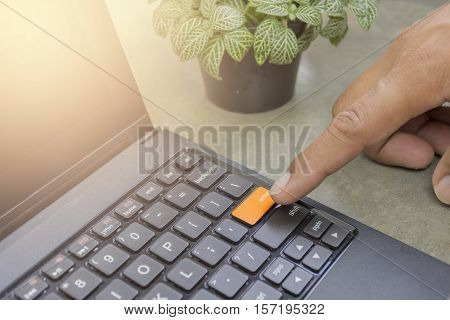 Man Business Finger Pushing The Button Enter Yellow On The Keyboard, Hand Pushing The Enter Key On C
