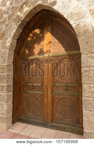 Entrance to the Palace of the Counts of Cervellon arabic pattern Anna Valencia Spain three quarter view of doors and lintel