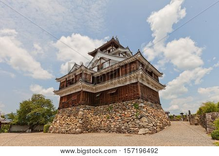 FUKUCHIYAMA JAPAN - JULY 29 2016: Reconstructed main keep (donjon) of Fukuchiyama castle. Castle was erected in 1579 by Akechi Mitsuhide abandoned in 19th c. reconstructed in 1985