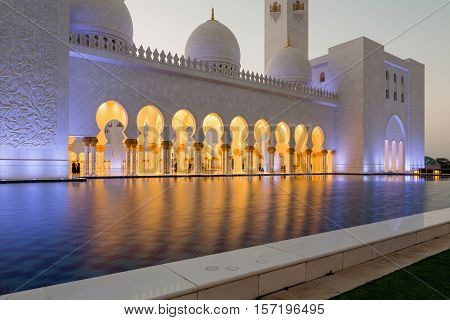 Charming architecture Sheikh Zayed Grand Mosque in beautiful evening lighting. Amazing Mosque. Sheikh Zayed Grand Mosque at sunset time (Abu-Dhabi UAE). Sheikh Zayed. Abu Dhabi