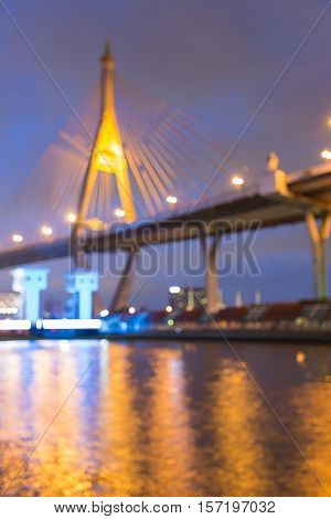 Blurred lights nigh view Suspension over watergate, abstract background