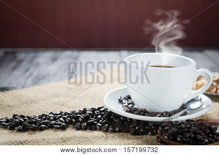 Coffee Cup And Beans On A Rustic Background. Coffee Espresso And A Curl. Cup Of Coffee And Coffee Be
